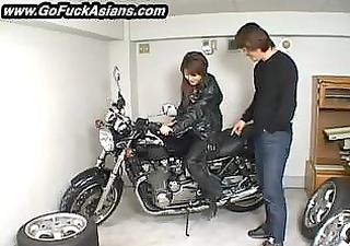asian bikerchick receives her love tunnel tickled